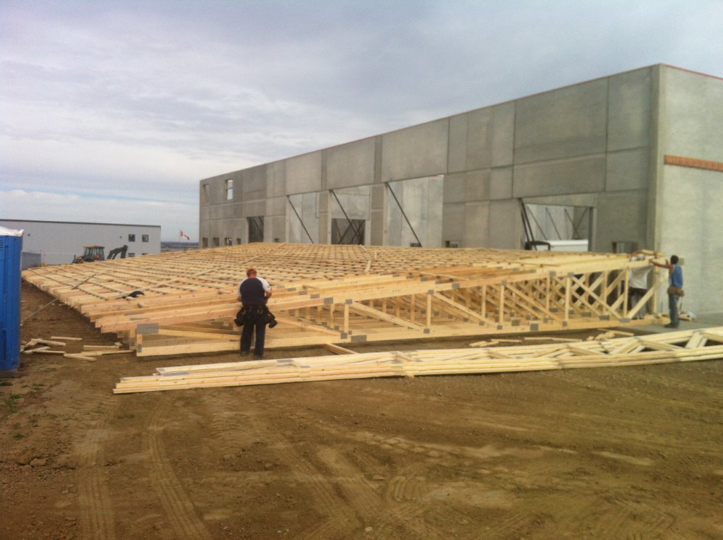 Insulated Precast Panel Building With Wood Trusses